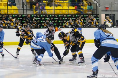 Buffalo Beauts forward Kristin Lewicki (27) and Boston Pride forward Corey Stearns (9) take the opening face off