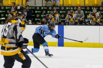 Buffalo Beauts forward Hayley Scamurra (14) rips a shot on net