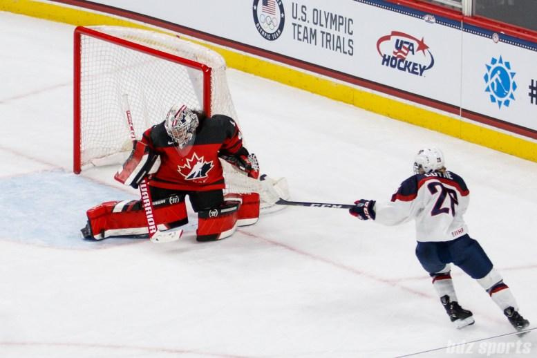 Team Canada goalie Shannon Szabados (1) makes a pad save against a backhanded shot from Team USA forward Kendall Coyne (26)