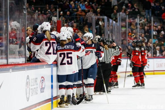 Team USA bench during a break in play