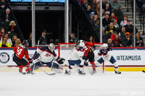 Team Canada forward Marie-Philip Poulin (29) beats Team USA goalie Maddie Rooney (35) to find the back of the net and tie up the game at 1-1