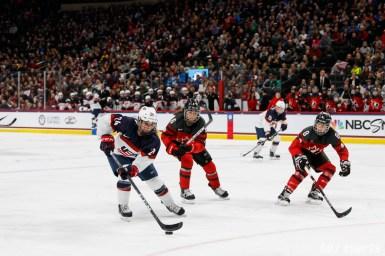 Team USA forward Dani Cameranesi (24) controls the puck for Team USA