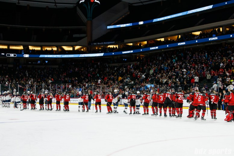 Team Canada and Team USA shake hands after Team Canada defeated Team USA 2-1 in overtime on December 3, 2017