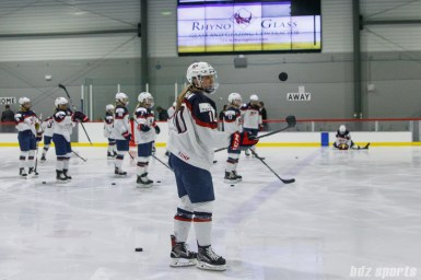 Team USA captain Meghan Duggan (10) warms up prior to the start of the game