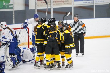 Boston Blades players celebrating teammate Meghan Grieves; (17) goal