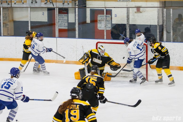 Toronto Furies forward Emily Fulton (17) redirects the puck into the back of the Boston goal