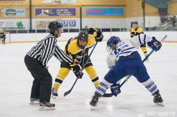 Boston Blades forward Erin Kickham (6) takes the face off against Toronto Furies forward Carolyne Prevost (27)