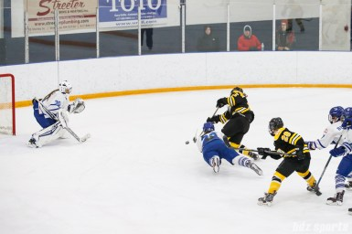 Toronto Furies defender Ella Stewart (22) dives in attempt to block Boston Blades forward Megan Myers' (15) shot on goal