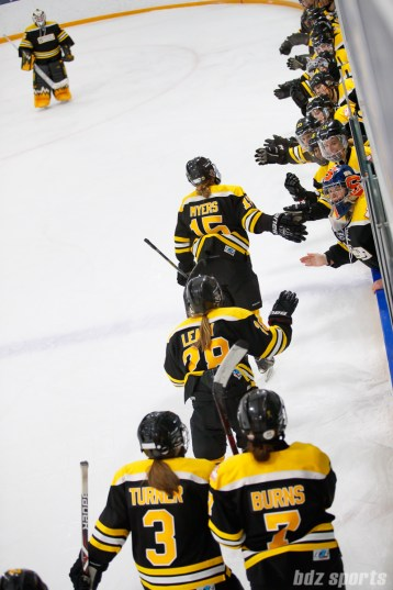 The Boston Blades high five the bench after Megan Myers' goal