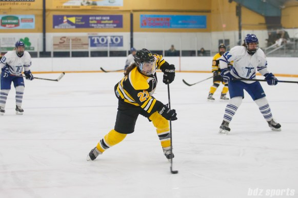 Boston Blades forward Melissa Bizzari (23) takes a shot on net