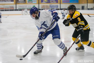 Toronto Furies forward Shannon Stewart (10) controls the puck for the Furies while being defended by Boston Blades forward Courtney Turner (3)