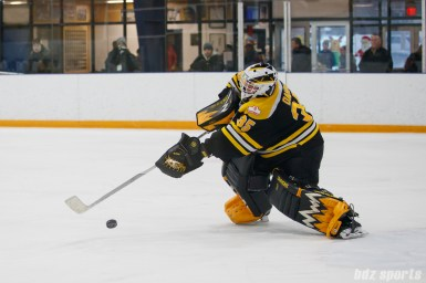 Boston Blades goalie Lauren Dahm (35) sends the puck out