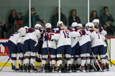 Team USA huddles before the start of the game