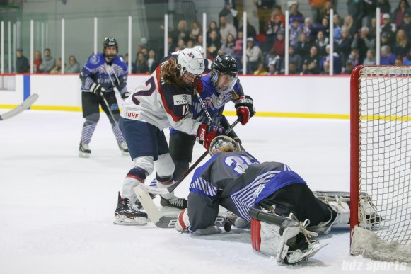 Team NWHL goalie Katie Fitzgerald (35) smothers the puck from Team USA forward Kelly Pannek (12)