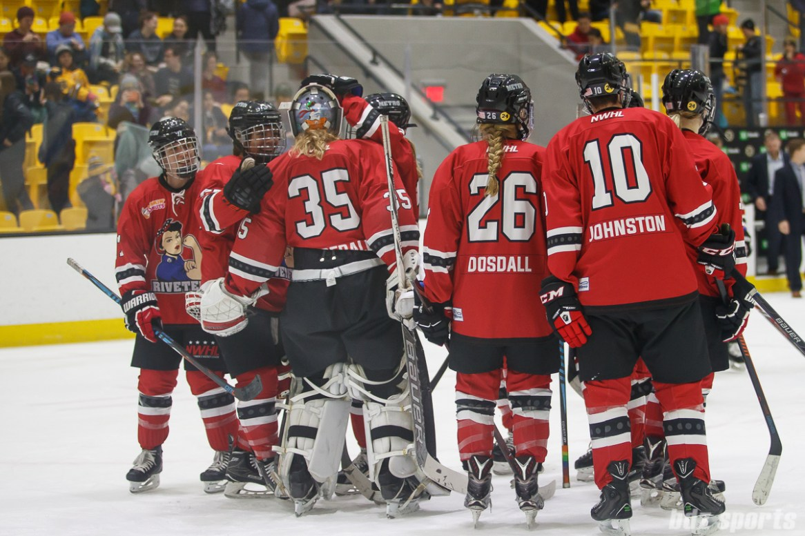The Metropolitan Riveters congratulate goalie Katie Fitzgerald (35) after their 5-1 win over the Boston Pride