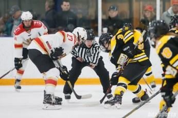 Kunlun Red Stars forward Shiann Darkangelo (27) faces off against Boston Blades forward Courtney Turner (3)