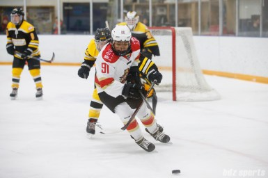 Kunlun Red Stars forward Rachel Llanes (91) looks to control the puck while being defended by Boston Blades defender Dru Burns (7)