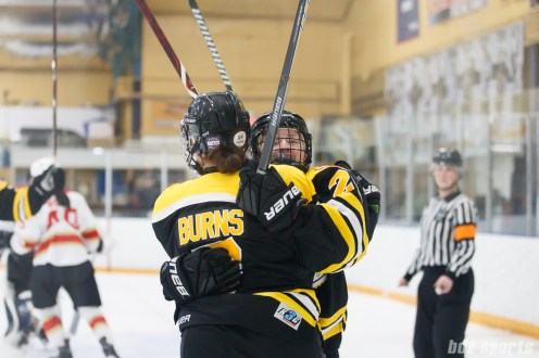 Boston Blades forward Kate Leary (28) celebrates teammate Dru Burns' (7) goal in the second period which tied the game at 1-1