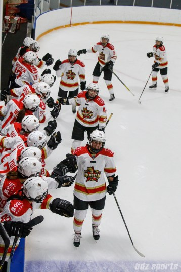 Kunlun Red Stars forward Kelli Stack (16) high fives the bench after scoring a goal in the second period