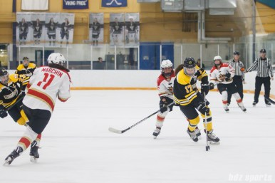 Boston Blades forward Meghan Grieves (17) brings the puck up ice