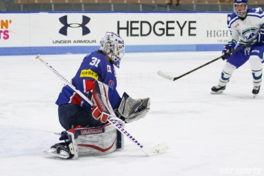 Team South Korea goalie So Jung Shin (31) collects the puck