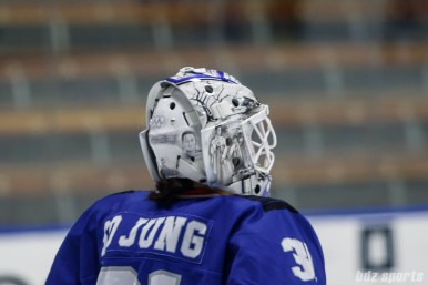 A close look at Team South Korea goalie So Jung Shin's (31) goalie mask