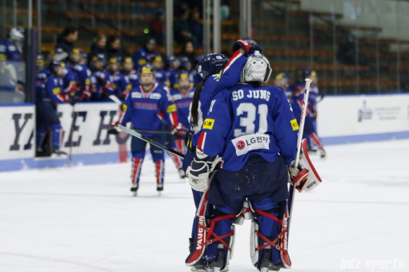 Team South Korea forward Jin Gyu Lee (29) hugs goalie So Jung Shin (31) after the game