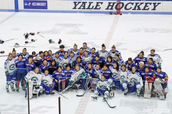 Members of Team South Korea and Connecticut Whale pose for a photograph after the game