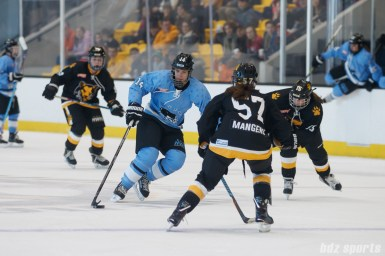 Buffalo Beauts forward Hayley Scamurra (14) brings the puck up through the neutral zone