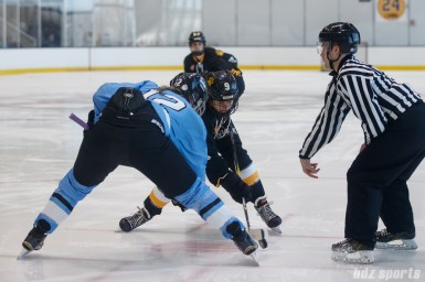 Buffalo Beauts forward Rebecca Vint (12) takes the face off against Boston Pride forward Corey Stearns (9)