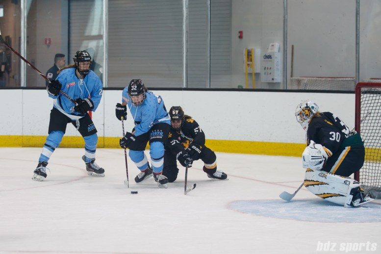 Boston Pride defender Meagan Mangene (57) looks to block a shot from Buffalo Beauts forward Jess Jones (32)