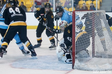 The backhand shot from Buffalo Beauts forward Hayley Scamurra (14) hits off the post and goes in for the Beauts' third goal of the game