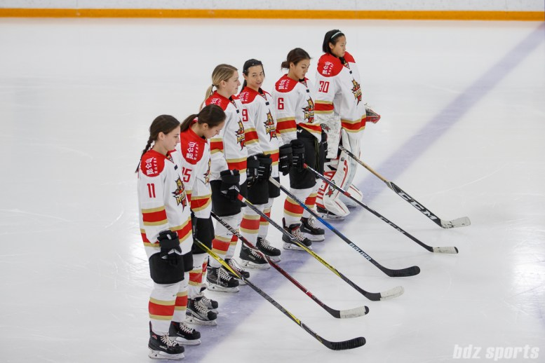 The starting line for the Kunlun Red Stars: Taylor Marchin (11), Madison Woo (15), Shiann Darkangelo (27), Jessica Wong (49), Melanie Jue (6), Yuqing Wang (30)