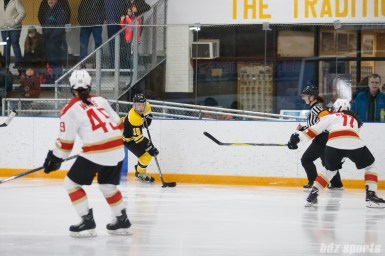 Boston Blades forward Megan Myers (15) brings the puck down ice