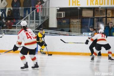 Boston Blades forward Megan Myers (15) brings the puck down ice
