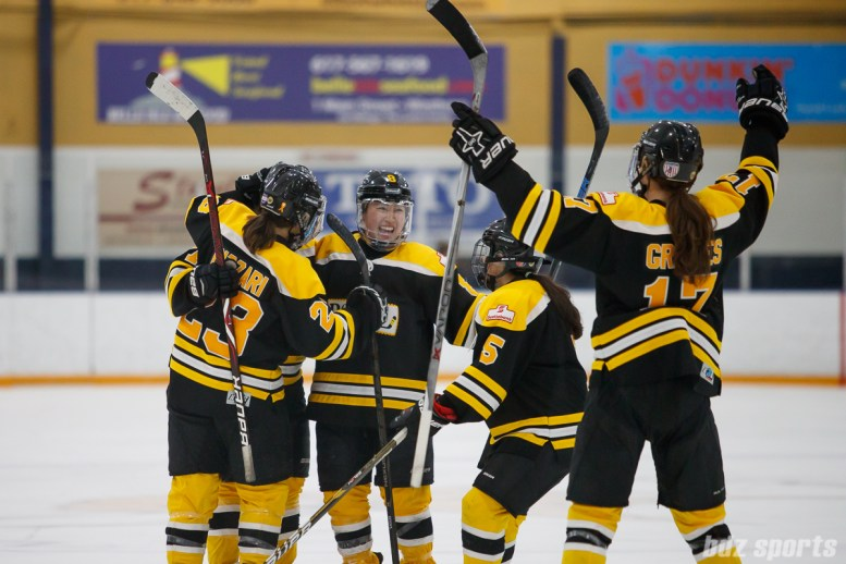 The Boston Blades celebrate teammate Dru Burns' (7) goal in the second period