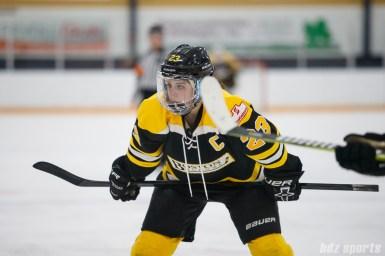 Boston Blades forward Melissa Bizzari (23) prepares to take the faceoff