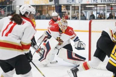 Kunlun Red Star goalie Noora Raty (41) tracks the puck behind the net