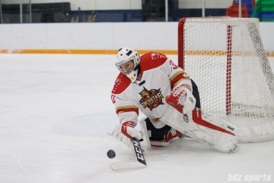 Kunlun Red Star goalie Yuqing Wang (30) stops the puck
