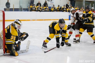 Boston Blades defender Dru Burns (7) prepares to block the puck