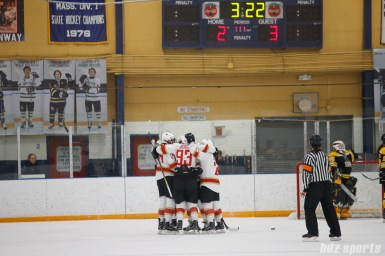 The Kunlun Red Star celebrate teammate defender Zhixin Liu's (93) goal in the third period, which would go on to be the game-winning goal