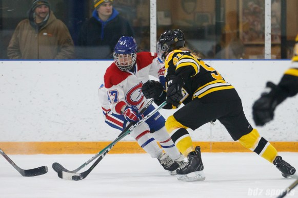 Montreal Les Canadiennes forward Emmanuelle Blais (47) looks to maintain possession while being challenged by Boston Blades defender Jordan Hampton (91)