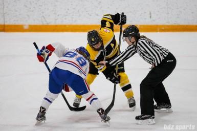 Boston Blades forward Erin Kickham (6) takes the faceoff against Montreal Les Canadiennes forward Kayla Tutino (88)