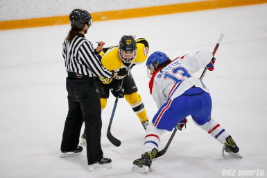 Boston Blades forward Nicole Giannino (27) and Montreal Les Canadiennes forward Caroline Ouellette (13) take a faceoff