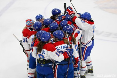 The Montreal Les Canadiennes celebrate their 5-4 shootout win over the Boston Blades