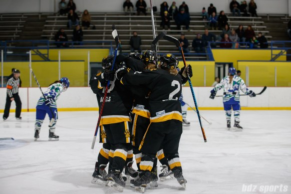 The Boston Pride celebrate Sydney Daniels' (19) goal
