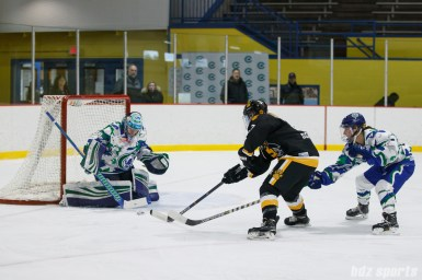 Connecticut Whale goalie Sydney Rossman (34) comes up with the stop against Boston Pride forward Heather Schwarz (37)