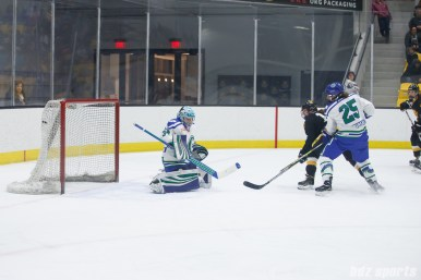 Boston Pride forward Jillian Dempsey (14) redirects puck for the Pride's second goal of the game