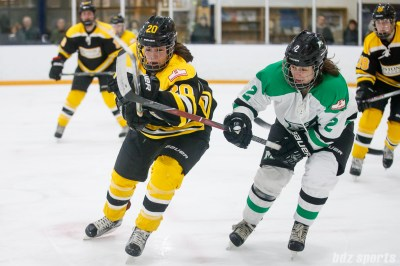 Boston Blades defender Meaghan Spurling (20) and Markham Thunder forward Becca King (2)