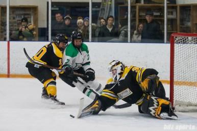 Boston Blades goalie Lauren Dahm (35) pushes the puck away